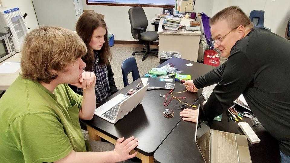 Matt Gehrett, right, works with two of his students at�Chawanakee�Academy Charter School