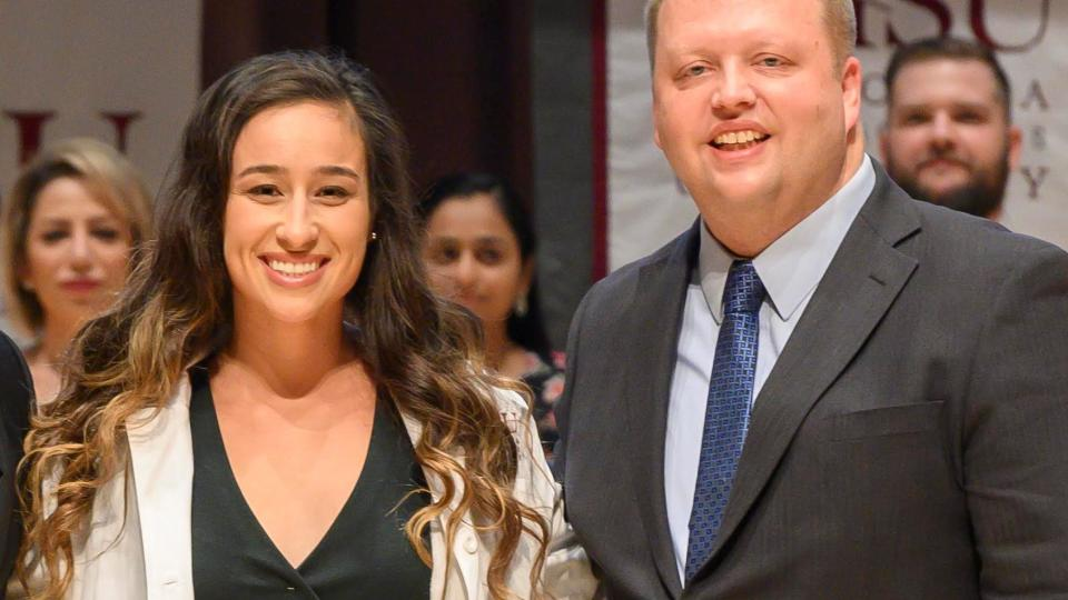 Savannah Mangrum, left, and Will Ofstad, PharmD, BCPS, CDE, director of the CHSU Office of Teaching and Learning and assistant dean for education at the CHSU College of Pharmacy at Mangrum?s 2019 White Coat Ceremony. (Photo courtesy California Health Sciences University)