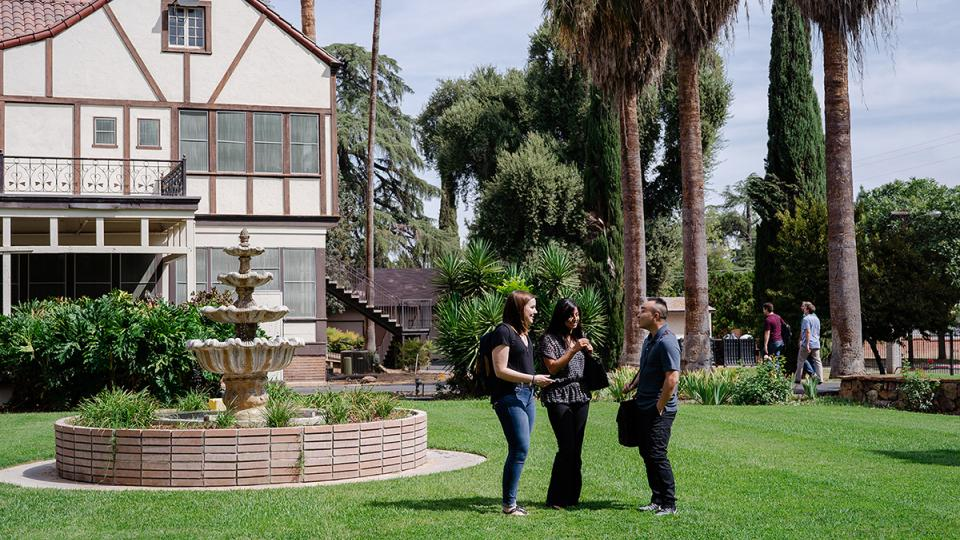 Fresno Pacific Biblical Seminary photo of house, fountain and students