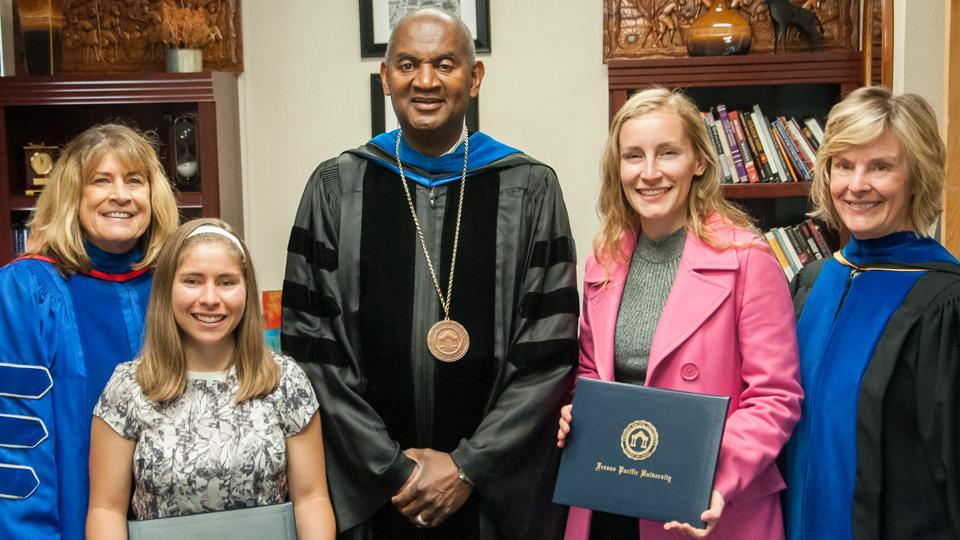 President, provost, and professor with award-winning students