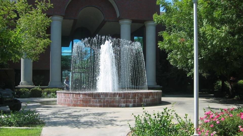McDonald Hall at Fresno Pacific University featuring the fountain.