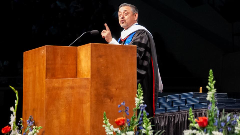 Noel Castellanos speaks at the December 2018 commencement ceremony for Fresno Pacific University