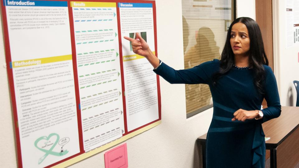"FPU graduate student Pawandeep Kaur explains her poster presentation: ""Polycystic Ovary Syndrome (PCOS): an under-recognized Cardiovascular risk factor in women"" at the Graduate Research Symposium."