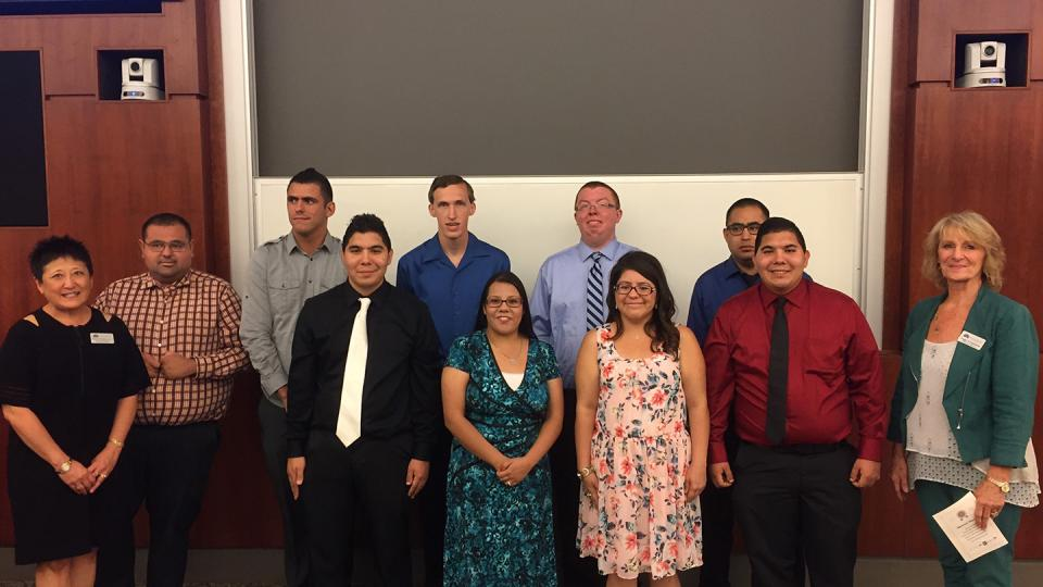 Interns and FPU Continuing Education officials celebrate graduation.