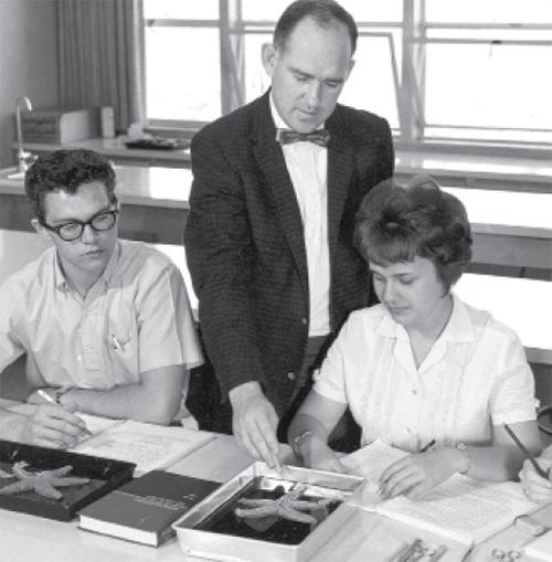 Donald Braun teaching in science classroom