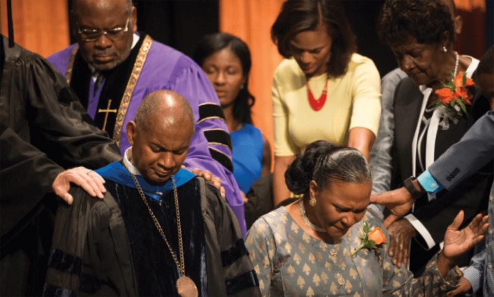 President Joseph Jones and wife Ivette Jones are prayed over at convocation