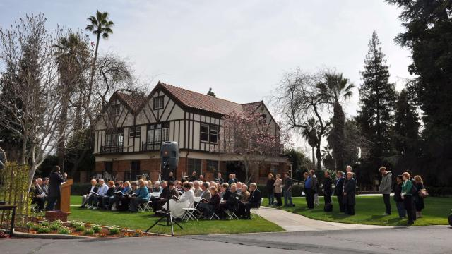Gathering on Seminary House green for alumnus funeral
