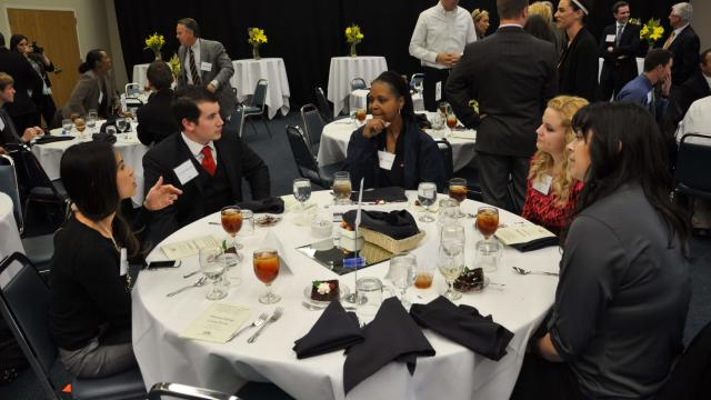 Students at professional luncheon organized by career services