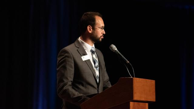 Aaron Henderson speaks to a group