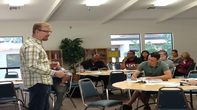 Fresno Pacific University instructor Andrew Shinn teaches a group of participants at the 2018 Social Business Plan Workshop