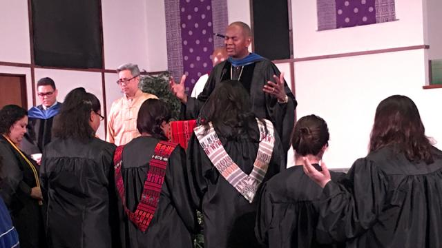 President Joseph Jones leading prayer at Baccalaureate Ceremony
