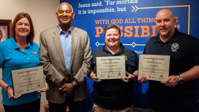 Photo of (from left): Kimberly Self, FPU President Joseph Jones, Schock and Eric Self