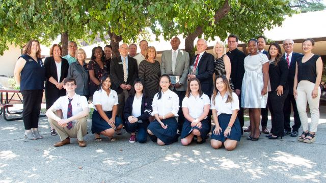 Adminstrators, faculty, staff and students from San Joaquin Memorial High School pose with leaders of Fresno Pacific University to celebrate international students partnership.