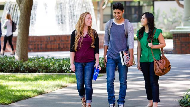Students walking near the McDonald Hall fountain on the main campus