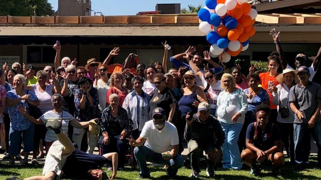 Residents of Senior Citizens Village south of the main FPU campus pose with students and staff at the Good Neighbor Block Party