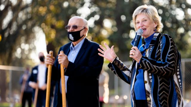 Al, left, and Dotty Warkentine speak at groundbreaking before turning earth.