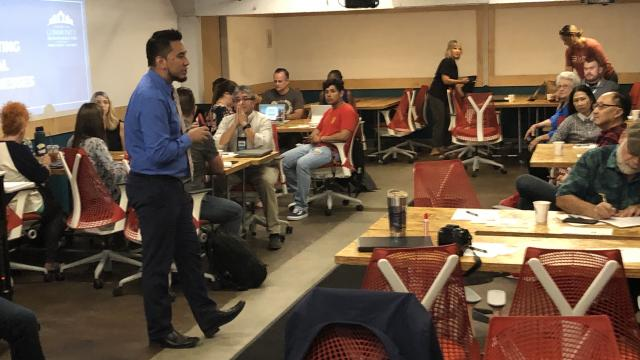 Carolos Huerta of the Center for Community Transformation addresses participants of the Social Business Plan Workshop