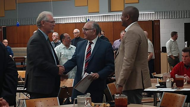 From left in photo: Randy White, Mayor Lee Brand and Matthew Grundy, former director of Habitat for Humanity Fresno County, chat at the Mayor's Faith Based Partnership Council meeting