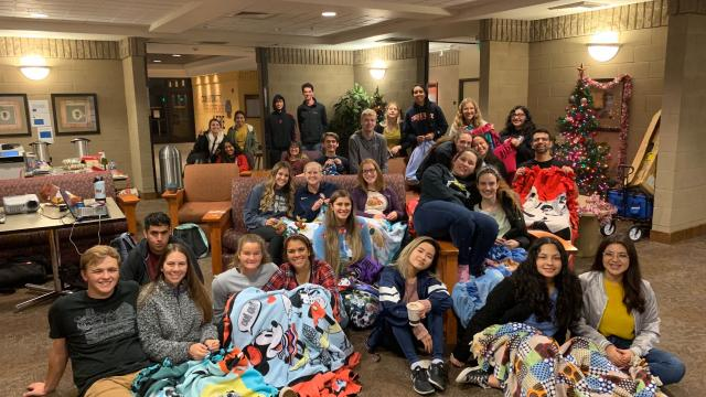 Students pose for the camera during the FPU blanket-tying event