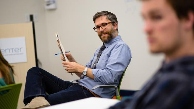 Adam Schrag, Ph.D., associate professor of communication at Fresno Pacific University, enjoys class