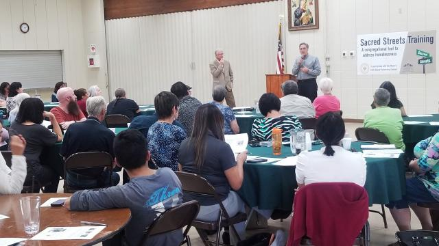Community leader H Spees speaks to 95 participants at Sacred Streets training