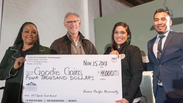 Sabrina Kelly, community relations manager, Wells Fargo; Randy White, executive director, FPU Center for Community Transformation; Gloria Leal, Goodie Gains; Carlos Huerta, CCT program director for community initiatives celebrate Goodie Gains' top prize of $4,000 at the CCT Spark Tank Pitch Fest (Photo provided by CCT)