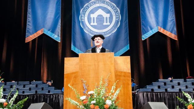 Fresno Pacific University commencement speaker Johann Matthies onstage at Selland Arena