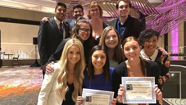 Student editors and advisor Leann Lo at the 2020 ACP Midwinter National Journalism Convention. Front row (from left): Samantha Rhoden, Nikki Campos and Shelbi Hayzlett. Middle row (from left): Brittney Banta, Abigail Brown and Leann Lo. Back row (from left): Austin Noronha, Timothy Myracle, Janelle Fontaine and Francesco Parisi.