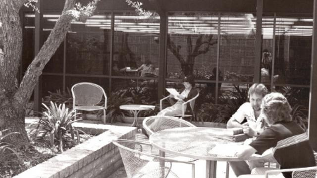 Old photo of two people sitting in the library garden